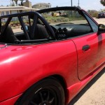 1999 5 speed Supercharged Red Miata